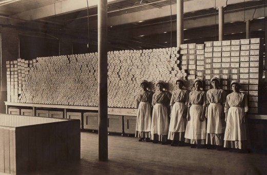 Employees in the Johnson & Johnson Cotton Mill in 1915 stand in front of surgical dressings.