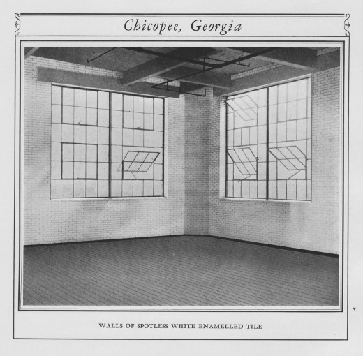 Interior detail of Chicopee Mill in Georgia, showing white enamelled tile on walls. From our archives.