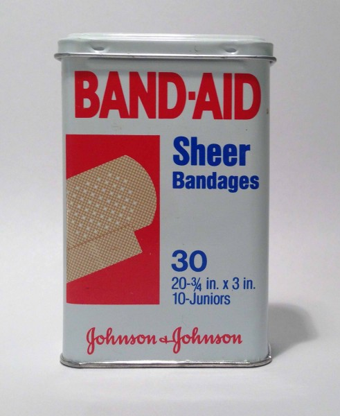 A BAND-AID® Brand Adhesive Bandages tin:  the package with a thousand uses!
