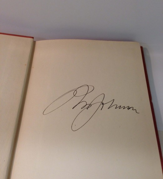 General Robert Wood Johnson's autograph on the book's front flyleaf!