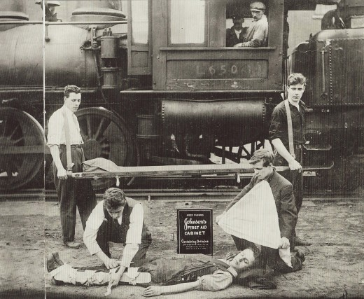 Railroad First Aid demonstration with a Johnson & Johnson First Aid Kit, from our archives.
