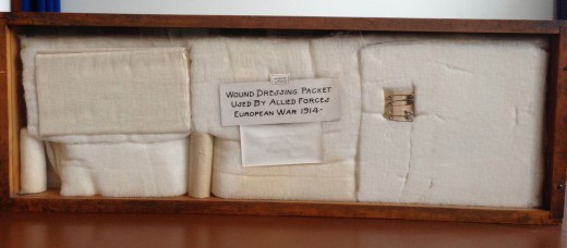 Shadowbox in the Johnson & Johnson Museum showing wound dressing packet developed by Johnson & Johnson during the war.