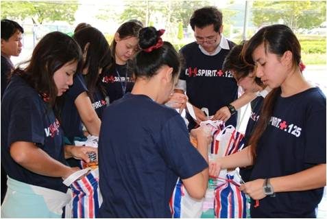 Employees at a Johnson & Johnson operating company in Thailand celebrate the Company's 125th anniversary in 2011 by packing disaster relief supplies to help families in the community.
