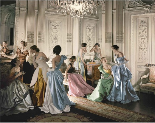 Eight models wearing Charles James gowns, in French & Company's eighteenth century French paneled room.