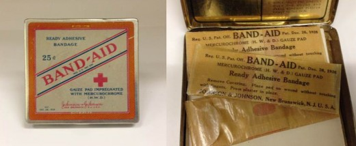 BAND-AID® Brand Adhesive Bandages tin from 1926 and its contents, donated by J.S.