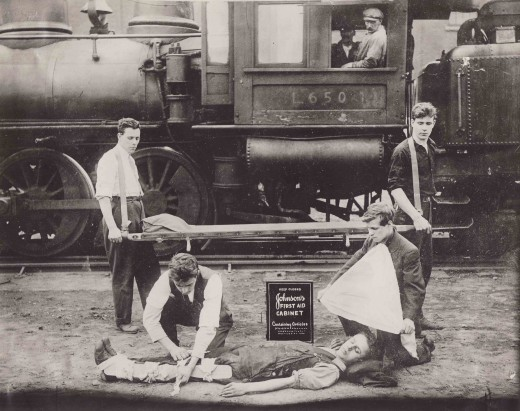 Railroad First Aid demonstration with a Johnson & Johnson First Aid Kit, 1916.  From our archives.