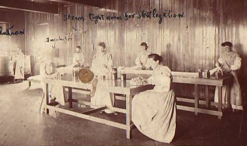 Women demonstrate pioneering sterile preparation of gauze and ligatures in 1891, in one of the earliest photos in the Johnson & Johnson archives.