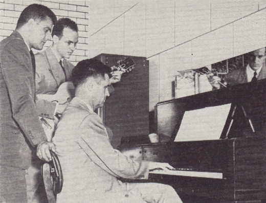 Vinnie Utz (far left) supervises an employee music session for the Johnson & Johnson radio show he managed during the 1940s.  From our archives.