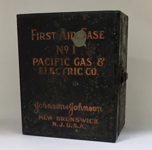 Rare Johnson & Johnson First Aid Kit made for the Pacific Gas & Electric Company, from our archives. The weathered condition of this very sturdy kit reflects the many decades it was in use by the family who received it.