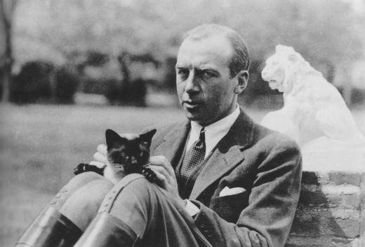 General Robert Wood Johnson and cat, 1940s, from our archives. Extra feline points for the lion statue in the background.