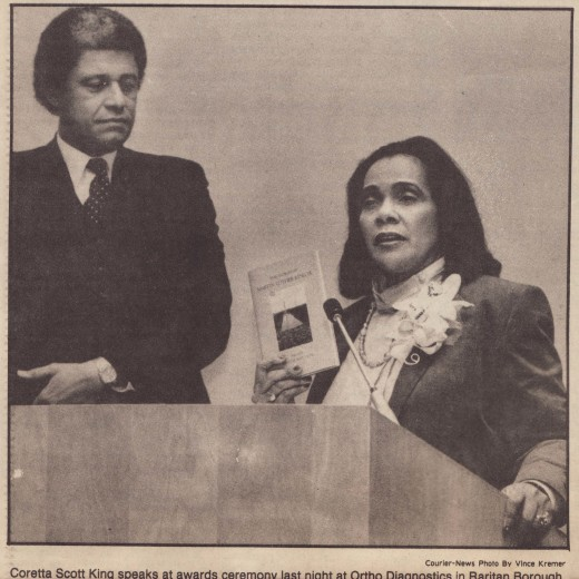 Aldrage B. Cooper speaks at an awards ceremony with civil rights leader Coretta Scott King, at a Johnson & Johnson facility in Raritan, NJ, 1985. From our archives.